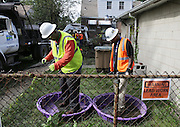 EPA contractors excavate contaminated soil Wednesday at a home in zone 3 in East Chicago.
