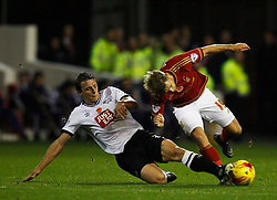 Stephen Warnock of Derby County (L) and Jamie Ward of Nottingham Forest in action - Mandatory byline: Jack Phillips / JMP - 07966386802 - 6/11/2015 - FOOTBALL - The City Ground - Nottingham, Nottinghamshire - Nottingham Forest v Derby County - Sky Bet Championship
