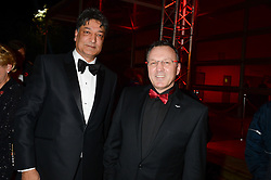 Left to right, BOBBY KAPOOR and MARK KENWORTHY General Manager Middle East of Aston Martin at the Collars & Coats Gala Ball in aid of Battersea Dogs & Cats Home held at Battersea Evolution, Battersea Park, London on 7th November 2013.