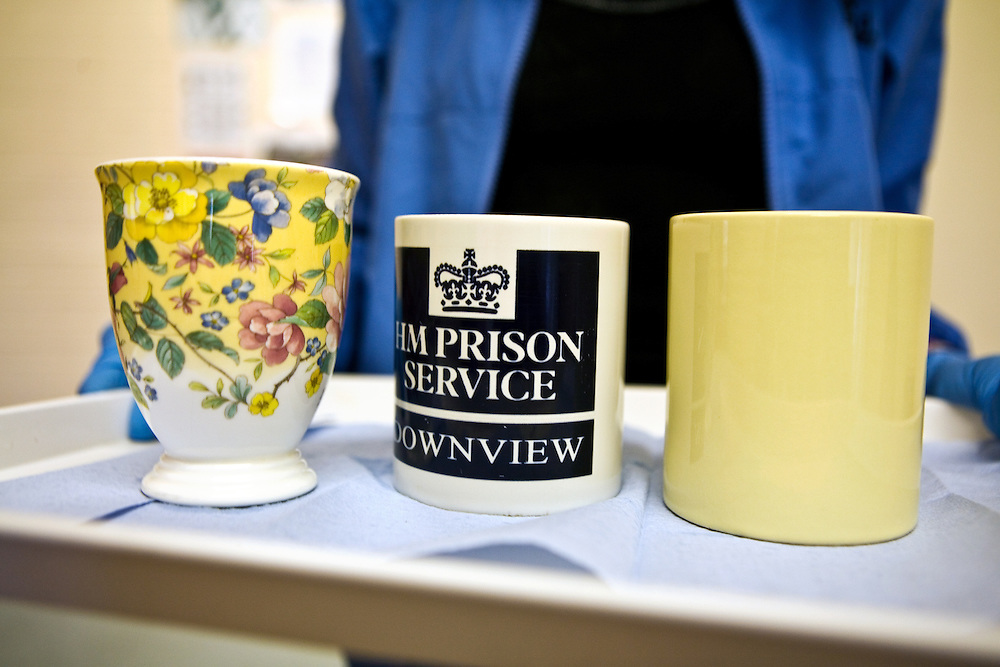 A prisoner making a tea round for the chapel staff at HMP Downview Women's Prison at Sutton in Surrey. Downview is closed prison for adult women and young female offenders (both remand and convicted).