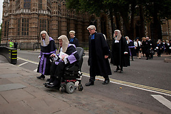 © Licensed to London News Pictures. 01/10/2013. London, UK. British judges make their way to the Houses of Parliament after a service to mark the start of the legal year held at Westminster Abbey in London today (01/10/2013). Photo credit: Matt Cetti-Roberts/LNP