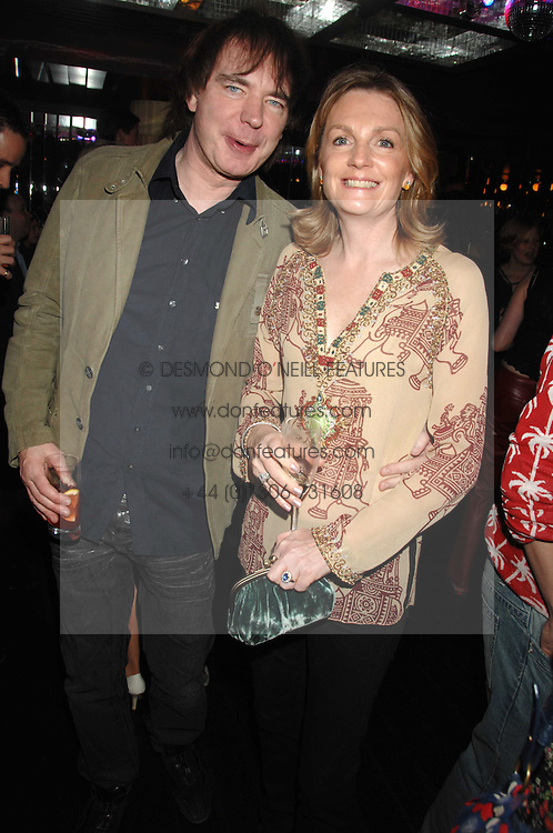 JULIAN LLOYD WEBBER and LADY LLOYD-WEBBER at a party to celebrate Imogen Lloyd Webber's 30th birthday and the launch of her Single Girl's Guide held at Vilstead, 9 Swallow Street, London on 27th March 2007.<br />