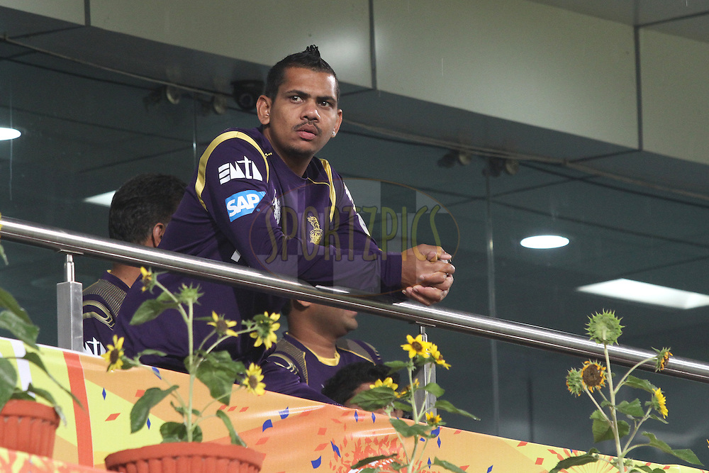 Sunil Narine of the Kolkata Knight Riders looks out as rain delays the start during match 21 of the Pepsi Indian Premier League Season 2014 between the Chennai Superkings and the Kolkata Knight Riders  held at the JSCA International Cricket Stadium, Ranch, India on the 2nd May  2014<br /> <br /> Photo by Shaun Roy / IPL / SPORTZPICS<br /> <br /> <br /> <br /> Image use subject to terms and conditions which can be found here:  http://sportzpics.photoshelter.com/gallery/Pepsi-IPL-Image-terms-and-conditions/G00004VW1IVJ.gB0/C0000TScjhBM6ikg
