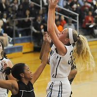 Hoggard's Emma Haywood shoots over New Hanover's Amani Muhammad Friday December 12, 2014 at Hoggard High School in Wilmington, N.C. (Jason A. Frizzelle)
