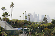 LOS ANGELES, CA - APRIL  21:  Palm trees wave in the breeze as the downtown Los Angeles skyline appears in a morning haze before the game between the Atlanta Braves and the Los Angeles Dodgers on Thursday, April 21, 2011 at Dodger Stadium in Los Angeles, California. The Dodgers won the game 5-3 in 12 innings. (Photo by Paul Spinelli/MLB Photos via Getty Images)