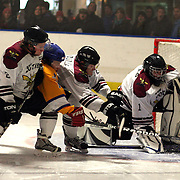 Southern Stampede player Adnan Mlivic is sandwiched between the Botany Swarm defence as he challenges for the puck during the Southern Stampede V Botany Swarm National Ice Hockey League match at the Queenstown Ice Arena , South Island, New Zealand, 2nd July  2011
