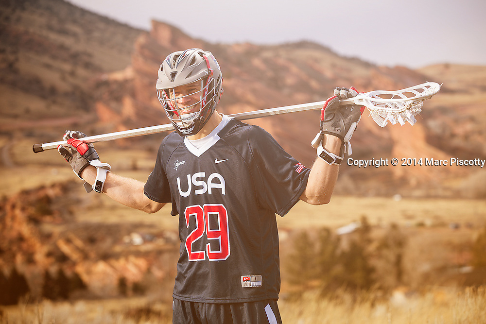 SHOT 2/22/14 5:02:40 PM - Denver Outlaws and Team USA defenseman Lee Zink poses for a portrait with Red Rocks and the foothills just outside of Denver, Co. in the background. Zink was named the 2012 Major League Lacrosse Defensive Player of the Year. When Zink grew up in Darien, Conn., and started his lacrosse career in sixth grade, he knew defense would be his calling card from the beginning. Zink will be playing in Denver this summer in the 2014 FIL World Lacrosse Championships.<br /> (Photo by Marc Piscotty / &copy; 2014)