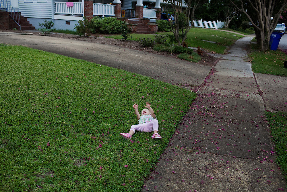 Madelyn Eich cries out for her mother while lying in in the grass Norfolk, Virginia.