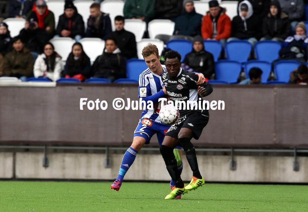19.4.2015, Sonera stadion, Helsinki.<br /> Veikkausliiga 2015.<br /> Helsingin Jalkapalloklubi - FC Lahti..<br /> Hassan Sesay (FC Lahti) v Alex Lehtinen (HJK).