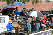 Umbrellas are up in the stands as a shower passes over as the start of play is delayed during the Specsavers County Champ Div 1 match between Somerset County Cricket Club and Essex County Cricket Club at the Cooper Associates County Ground, Taunton, United Kingdom on 25 September 2019.