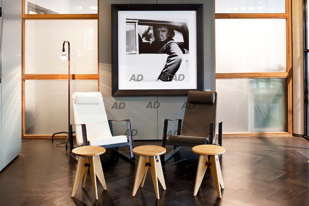 The headquarters of G-Star. At the entrance of the company, Portrait of singer Johnny Cash, stool Tabouret Solvay of 1941 and the chairs Cité  of 1930 of  Prouvé RAW collection.
