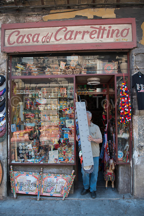 A tourist souvenir shop is opening its doors