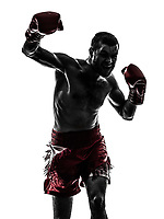one  man exercising thai boxing in silhouette studio on white background