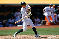 OAKLAND, CA - JULY 28:  Chad Pinder #18 of the Oakland Athletics hits a two run double against the Texas Rangers during the sixth inning at the RingCentral Coliseum on July 28, 2019 in Oakland, California. The Oakland Athletics defeated the Texas Rangers 6-5. (Photo by Jason O. Watson/Getty Images) *** Local Caption *** Chad Pinder