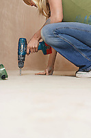 Woman drilling floor low section