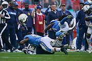 Los Angeles Chargers Mike Pouncey C (53) loses his helmet during the International Series match between Tennessee Titans and Los Angeles Chargers at Wembley Stadium, London, England on 21 October 2018.