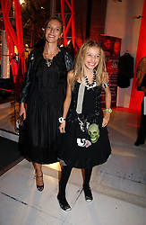 TIFFANY CHAPMAN wife of artist Dinos Chapman and their daughter AGATHE CHAPMAN at a party to celebrate the launch of DKNY Kids and Halloween in aid of CLIC Sargent and RX Art held at DKNY, 27 Old Bond Street, London on 31st October 2006.<br /><br />NON EXCLUSIVE - WORLD RIGHTS