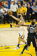 Golden State Warriors guard Klay Thompson (11) takes the ball the the basket against the San Antonio Spurs at Oracle Arena in Oakland, Calif., on October 25, 2016. (Stan Olszewski/Special to S.F. Examiner)