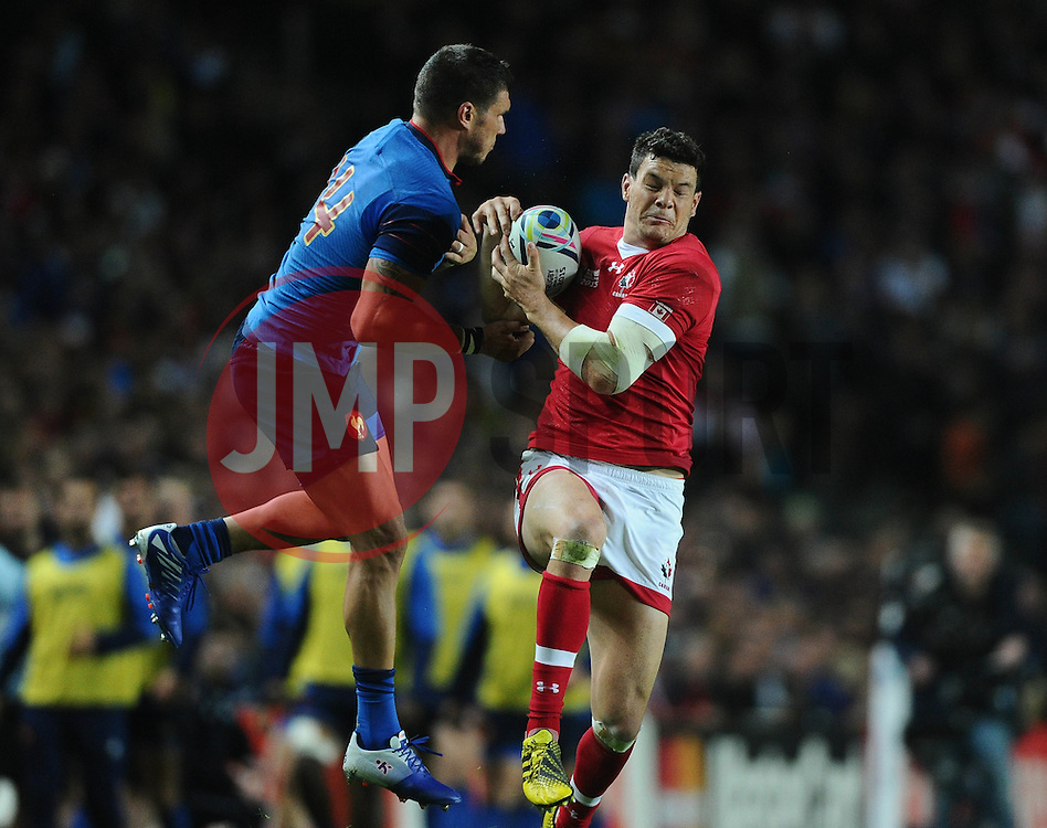 Ciaran Hearn of Canada beats Remy Grosso of France to the high ball from kick off  - Mandatory byline: Joe Meredith/JMP - 07966386802 - 01/10/2015 - Rugby Union, World Cup - Stadium:MK -Milton Keynes,England - France v Canada - Rugby World Cup 2015