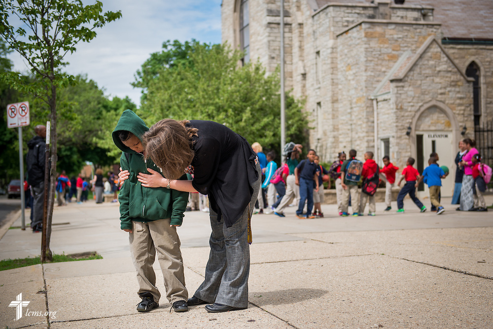 Principal Carrie Miller consoles Kamrin after class outside Mount Calvary Lutheran Church and School on Wednesday, May 28, 2014, in Milwaukee, Wis. LCMS Communications/Erik M. Lunsford