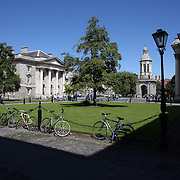 Bikes in the courtyard of Trinity College, Dublin. (Irish: Coláiste na Tríonóide), formally known as the College of the Holy and Undivided Trinity of Queen Elizabeth near Dublin, is the sole constituent college of the University of Dublin in Ireland. The college was founded in 1592. It is one of the seven ancient universities of Britain and Ireland, as well as Ireland's oldest university. Dublin, Ireland. Photo Tim Clayton