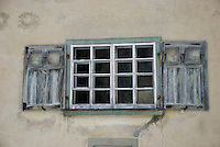 Windows and shutters on an old building in Einsiedeln, Switzerland.