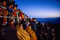 People bundled in blankets and warm clothes awaiting the sunrise on Tiger Hill, near Darjeeling, West Bengal, India
