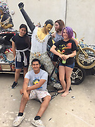 Students at Reagan HS decorate their art car for this year's Art Car parade.