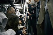 a Tokyo subway train during rush hour