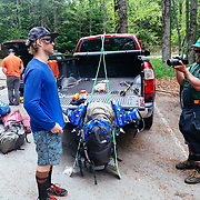 Loading up backpacks for a 10 mile/4000 foot vertical climb into the Sperry Chalet of Glacier National Park, Montana.