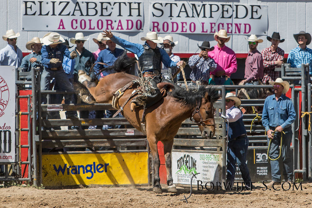 Saddle bronc rider Jacob Kammerer rides Summit Pro Rodeo's 814 Easy Rider in the first performance of the Elizabeth Stampede on Saturday, June 2, 2018.