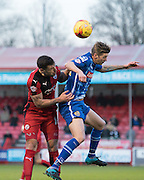 Crawley Town Defender Jon Ashton gets to the ball ahead of Notts County Forward Jonathan Stead during the Sky Bet League 2 match between Crawley Town and Notts County at the Checkatrade.com Stadium, Crawley, England on 16 January 2016. Photo by David Charbit.