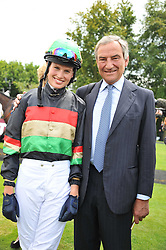 FRANCESCA CUMANI and her father trainer LUCA CUMANI at the 3rd day of the 2011 Glorious Goodwood Racing Festival - Ladies Day at Goodwood Racecourse, West Sussex on 28th July 2011.