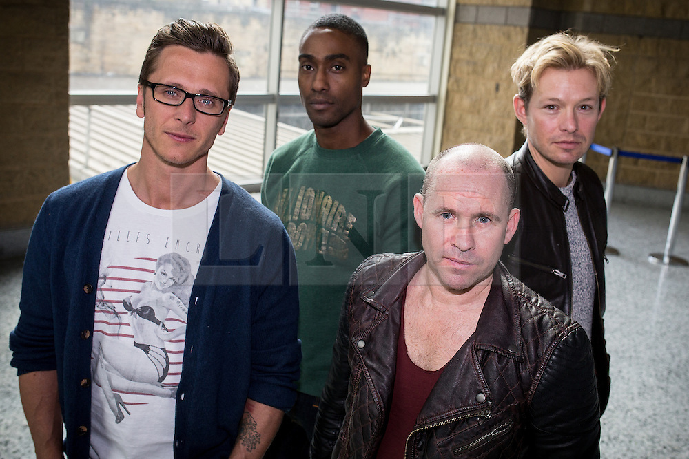 """© Licensed to London News Pictures . 14/04/2014 . Phones 4U Arena , Manchester , UK . L-R Ritchie Neville from Five , Simon Webbe from Blue , Simon """" Spike """" Dawbarn from 911 and Adam Rickitt . Photocall for former boyband stars as part of a reunion tour launch . Photo credit : Joel Goodman/LNP"""
