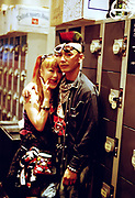 A couple, one with a Mohawk standing by some lockers, Japan, 2003