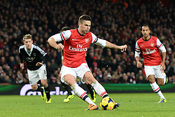 Arsenal's Oliver Giroud takes a penalty - Photo mandatory by-line: Mitchell Gunn/JMP - Tel: Mobile: 07966 386802 23/11/2013 - SPORT - Football - London - Emirates Stadium - Arsenal v Southampton - Barclays Premier League