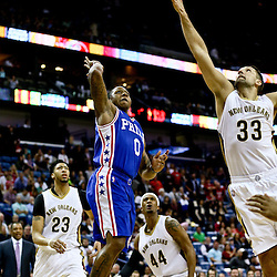 Feb 19, 2016; New Orleans, LA, USA; Philadelphia 76ers guard Isaiah Canaan (0) shoots over New Orleans Pelicans forward Ryan Anderson (33) during the second half of a game at the Smoothie King Center. The Pelicans defeated the 76ers 121-114. Mandatory Credit: Derick E. Hingle-USA TODAY Sports