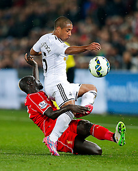 Wayne Routledge of Swansea City is tackled by Mamadou Sakho of Liverpool - Photo mandatory by-line: Rogan Thomson/JMP - 07966 386802 - 16/03/2015 - SPORT - FOOTBALL - Swansea, Wales — Liberty Stadium - Swansea City v Liverpool - Barclays Premier League.