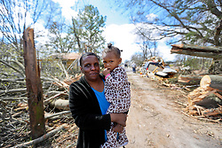 24 February 2016. Water tower Street, Convent, Louisiana.<br /> Devastation following a deadly EF2 tornado touchdown. 2 confirmed dead. <br /> Mary Williams (53 yrs) and granddaughter Leona Washington (2 yrs) survey the damage to their home.<br /> Photo©; Charlie Varley/varleypix.com