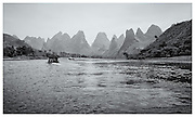 Boats working upstream on River Li, Guangxi Provence, China.