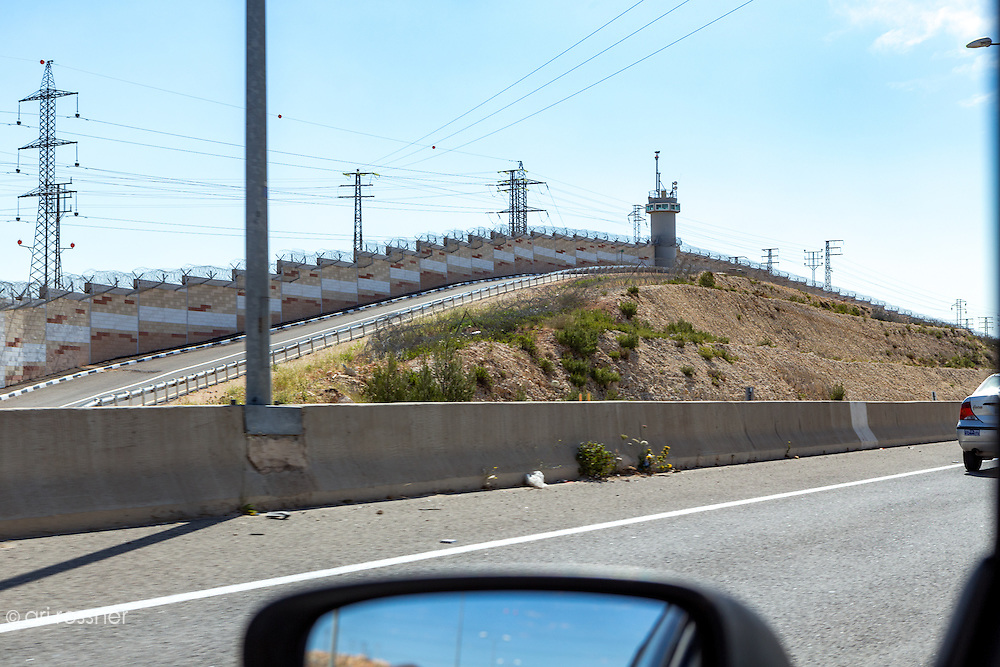 The new highway 443 leading to Jerusalem is passing thru the occupied territories. Walls were built on both sides of the highway to protect israely drivers and prevent Palestinians from going inside Israel.