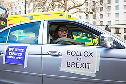 © Licensed to London News Pictures. 16/01/2018. London, UK.  An anti-Brexit protester with 'BOLLOX TO BREXIT' taped to the side of his car drives along Whitehall in London as MPs prepare to debate the EU Withdrawal Bill. Photo credit: Rob Pinney/LNP