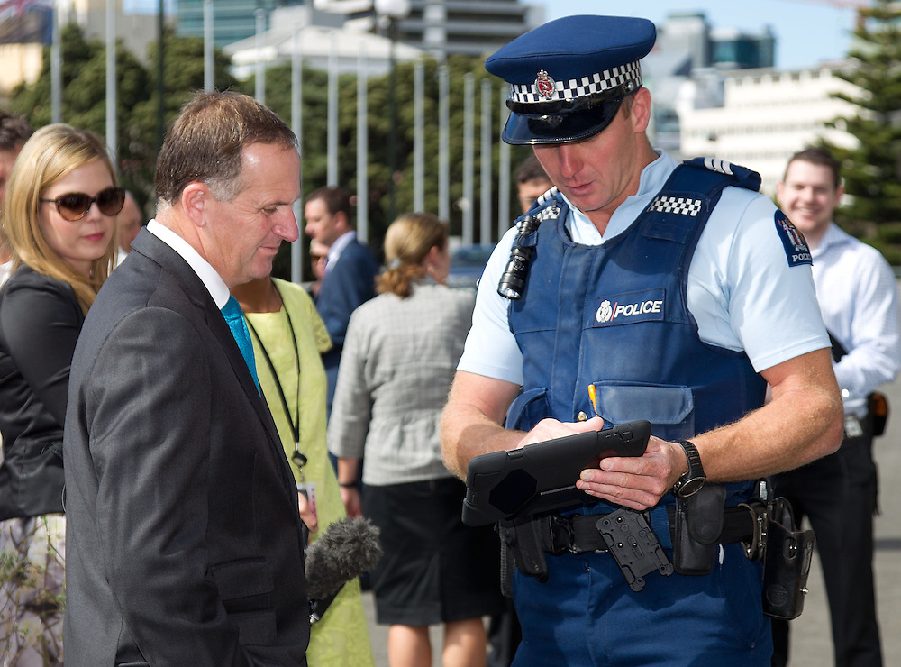 The Police show their newly issued iPads and iPhones to the Prime Minister John Key at a press conference at Parliament, Wellington, New Zealand, Wednesday, February 13, 2013. Credit: SNPA / Marty Melville