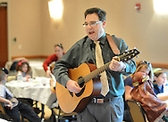 Cantor Paul Frimark sings a song as the children participate in seder dinner as part of Passover Palozza in preparation for the holiday Sunday April 17, 2016 at Congregation Beth El in Lower Makefield, Pennsylvania. (Photo by William Thomas Cain)