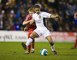 WARRINGTON, ENGLAND - Tuesday, February 26, 2008: Liverpool's Stephen Darby and Manchester United's Antonio Bryan during the FA Premiership Reserves League (Northern Division) match at the Halliwell Jones Stadium. (Photo by David Rawcliffe/Propaganda)