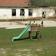 Kosovo, kids playing football during school time.