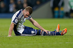 Callum McManaman of West Brom holds his leg on the ground - Photo mandatory by-line: Rogan Thomson/JMP - 07966 386802 - 11/02/2015 - SPORT - FOOTBALL - West Bromwich, England - The Hawthorns - West Bromwich Albion v Swansea City - Barclays Premier League.