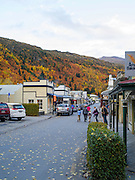 A view down Buckingham Street, Arrowtown, on an autumn day, with tourists milling about.