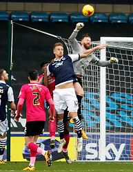 Ben Alnwick of Peterborough United punches the ball clear from Byron Webster of Millwall - Mandatory byline: Joe Dent/JMP - 20/02/2016 - FOOTBALL - The Den - Millwall, England - Millwall v Peterborough United - Sky Bet League One