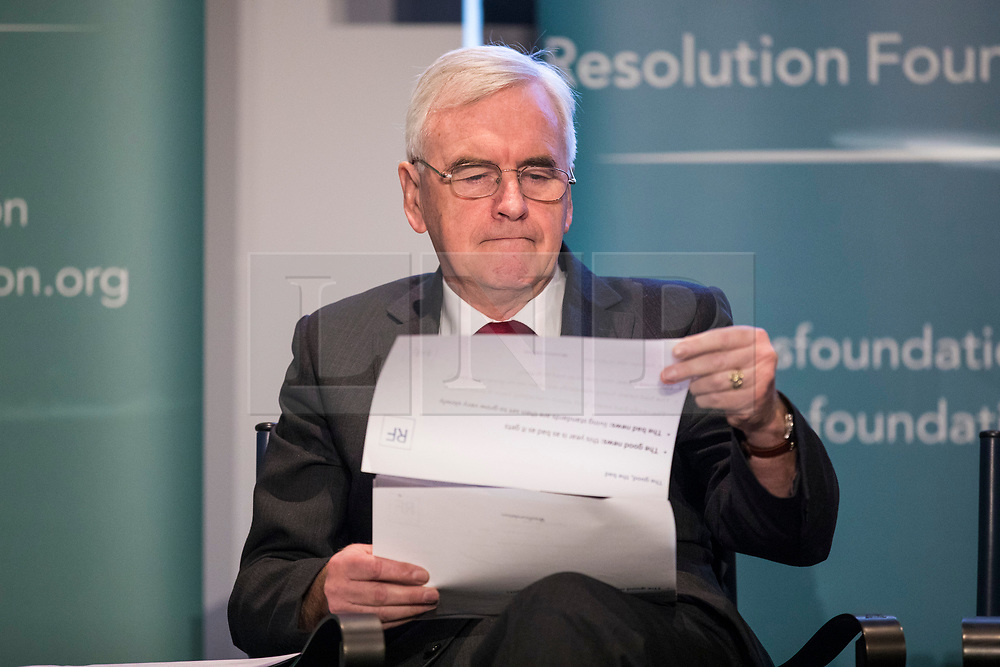 © Licensed to London News Pictures. 22/02/2018. London, UK. Shadow Chancellor John McDonnell MP looks through a report on prospects for growth in the British economy shortly before delivering a speech at the Resolution Foundation in Central London.Photo credit: Rob Pinney/LNP